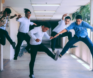 career move - staff jumping with joy