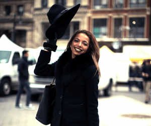 woman smiling taking hat off