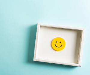 smiley face on a tray blue background